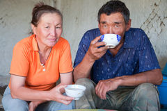 A man and a woman of Asian appearance have tea Stock Images