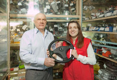 Man and woman   in  auto parts store Stock Image