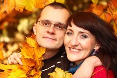 Man and woman with autumn leaves in hands Stock Photo