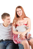 Man and woman with baby is sitting on chair Stock Images