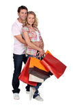 A man and a woman with  bags Royalty Free Stock Photos
