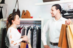 Man and woman with bags at store Royalty Free Stock Image