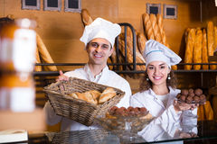 Man and woman bakers in bakery Stock Photos