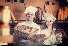 Man and woman bakers in bakery Royalty Free Stock Images