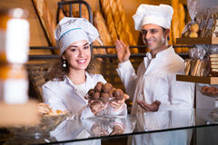 Man and woman bakers in bakery Stock Image