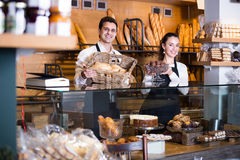 Man and woman bakers in bakery Royalty Free Stock Image