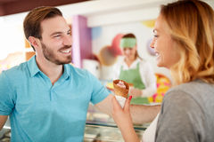 Man and woman in bakery taking ice cream Stock Photo