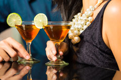 Man and woman at bar with cocktails. Man and woman flirting intimately at bar drinking cocktails Stock Photography