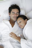 Man And Woman In Bathrobe Sleeping Together Royalty Free Stock Photo