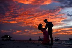 Man and Woman on Beach during Sunset Royalty Free Stock Photography