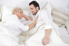 Man and woman in bed. Royalty Free Stock Image