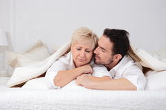 Man and woman in bed. Royalty Free Stock Images