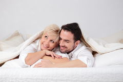 Man and woman in bed. Stock Photos