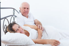 Man and woman on   bed Royalty Free Stock Photo