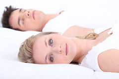 Man and woman in bed Stock Image