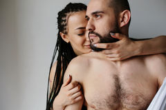 Man and woman in the bedroom Stock Image