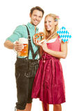 Man and woman with beer and pretzel Stock Photography