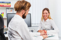Man and a woman being interviewed in the office Stock Images