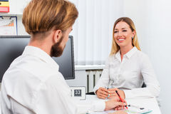 Man and a woman being interviewed in the office Royalty Free Stock Image
