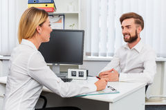 Man and a woman being interviewed in the office Stock Image