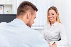 Man and a woman being interviewed in the office Stock Photo