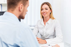Man and a woman being interviewed in the office Royalty Free Stock Photos