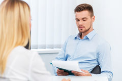 Man and a woman being interviewed in the office Stock Photography