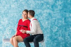 Man and woman on a bench Stock Photography