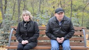 Man and woman on a bench stock video