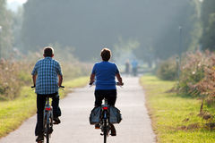 Man and woman on a bike Stock Image