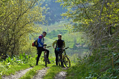 Man and woman on bikes Royalty Free Stock Photos