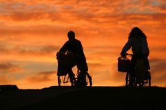 Man and a woman on bikes Royalty Free Stock Photography