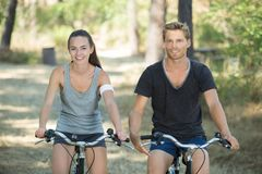 Man and woman on bikes Royalty Free Stock Photo