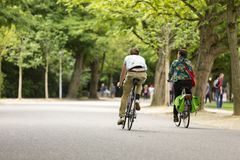 Man and woman biking in the Vondelpark. Stock Photo