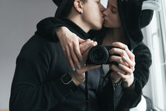 Man and woman in black clothes kissing stock photography