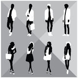 Man and Woman Black Silhouettes. Eight silhouettes of both sexes Royalty Free Stock Images