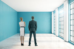 Man and woman in blue interior Stock Photos