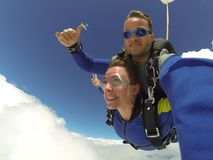 Man and Woman in Blue Jacket Doing Sky Diving stock photo