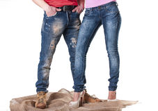 A man and a woman in blue jeans Stock Photos