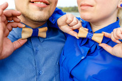 Man and woman in blue shirts with wooden bow tie Royalty Free Stock Image