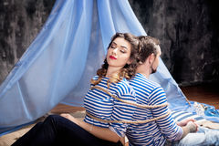 Man and woman bound with rope together. Concept Royalty Free Stock Photography