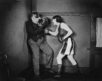 Man and woman boxing. (All persons depicted are no longer living and no estate exists. Supplier grants that there will be no model release issues Stock Image