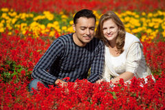Man and woman in braces in flowering park Stock Photos