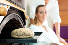 Man and woman in a bread sauna Stock Photos
