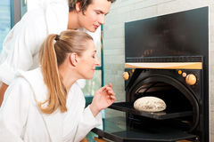 Man and woman in a bread sauna Royalty Free Stock Images
