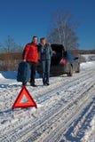 Man And Woman Broken Down car Royalty Free Stock Photography