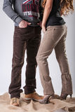 A man and a woman in brown corduroy trousers royalty free stock photos
