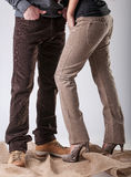 A man and a woman in brown pants Stock Photography