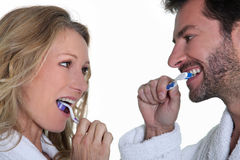 Man and woman brushing teeth Royalty Free Stock Photography