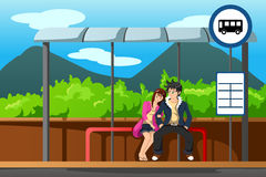 Man and woman at bus stop Stock Photo